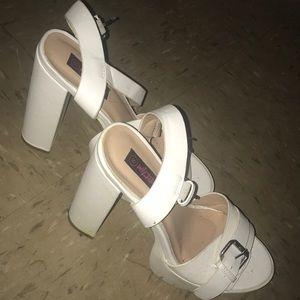 White chinky heels